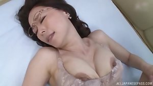 Asian matured opens her arms to be fucked by a stud in missionary
