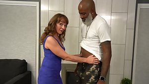 Horny older woman enjoys in MMF trio in the living-room