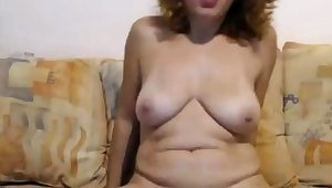 Mature wildly convulses foreign omibod on cam